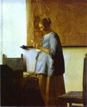 Woman in Blue Reading a Letter.